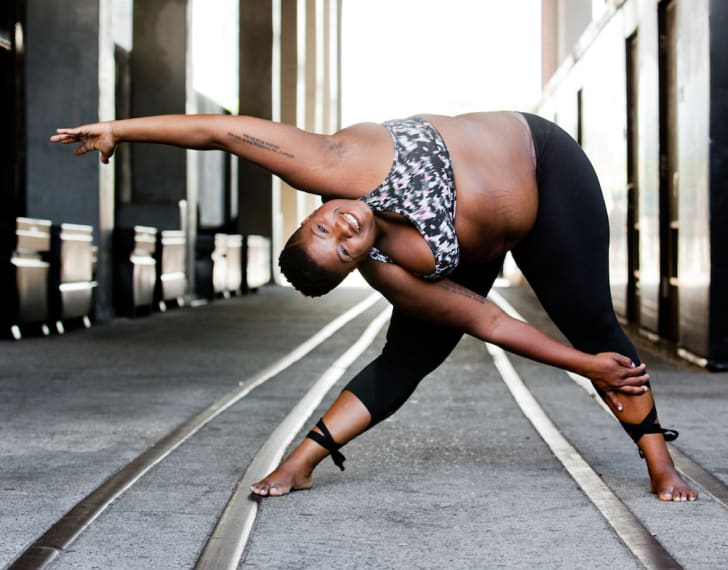 Yoga instructor Jessamyn Stanley in a triangle pose