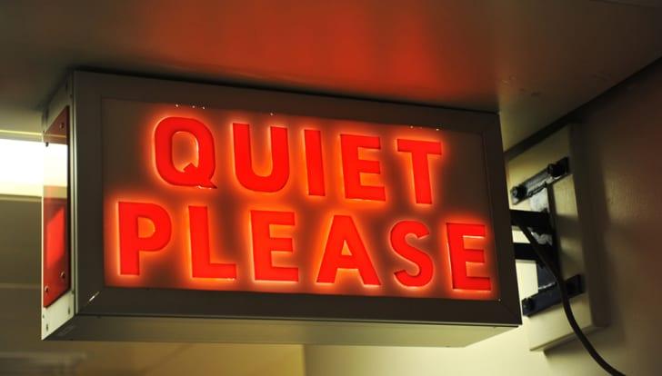 """A """"quiet please"""" sign lit up"""