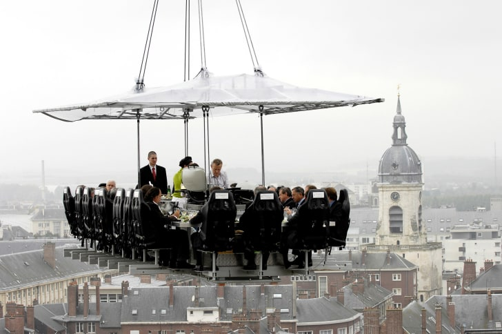Dinner in the Sky is a Belgian-based restaurant company that uses a crane-lifted platform to suspend its diners and servers 150 feet above ground.