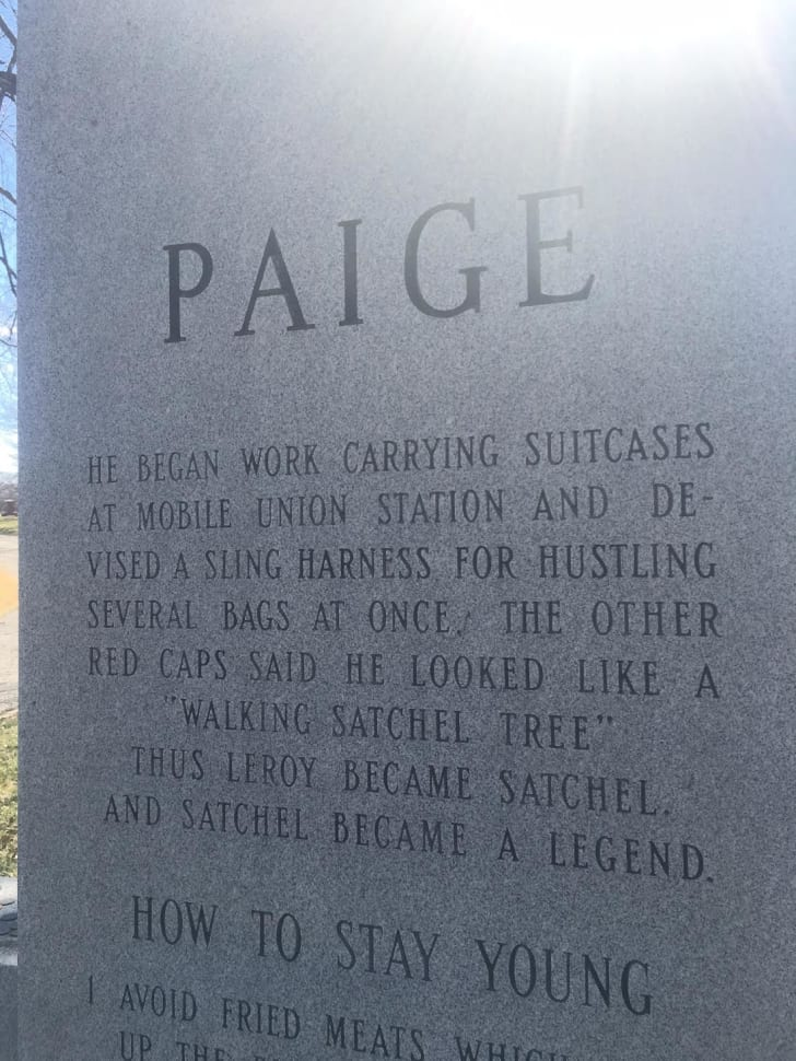 Close-up of an engraving on the gravestone of baseball player Satchel Paige that details how he got his nickname.