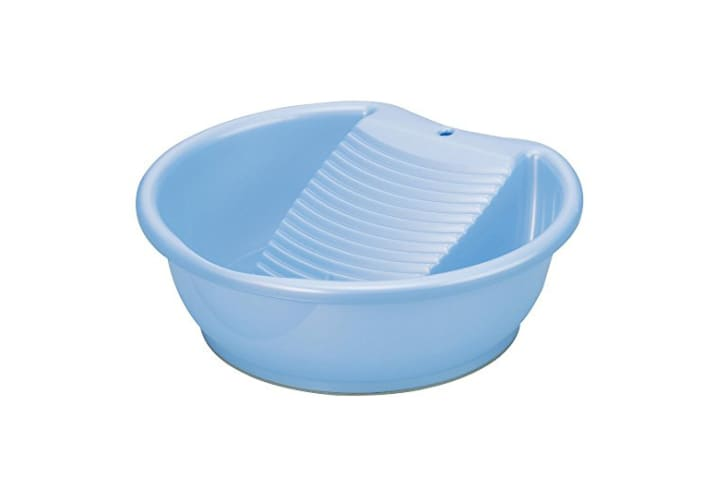 A blue plastic basin with a washboard