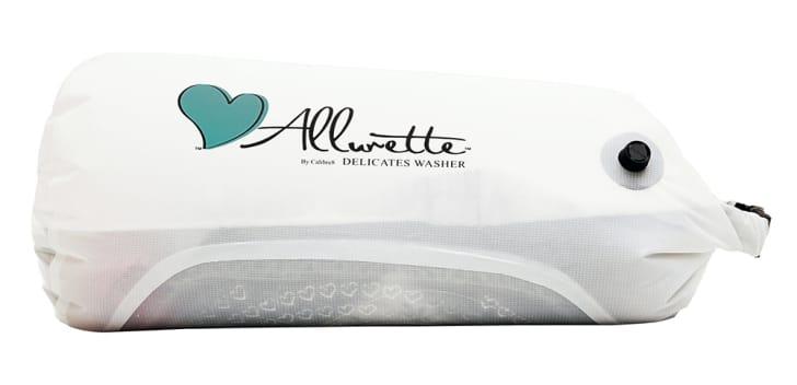 "A white wash bag that reads ""Allurette"""