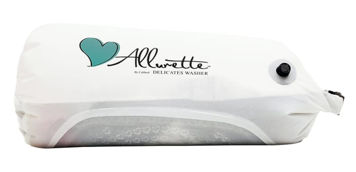 "A white wash bag that reads ""Allurette"""