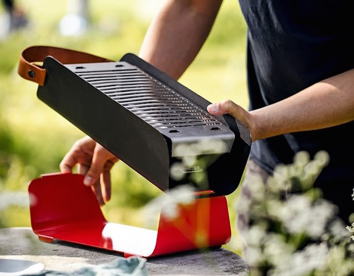 Putting together a portable grill.