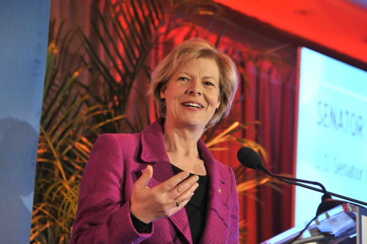 Tammy Baldwin speaks onstage at an EMILY's List gala