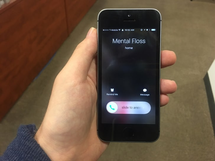 "An iPhone getting a call from ""Mental Floss"" reads ""slide to answer."""