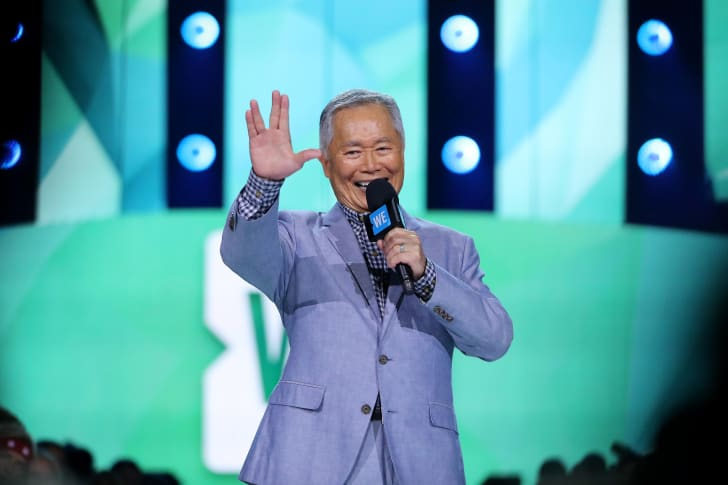 George Takei flashes a Vulcan salute onstage