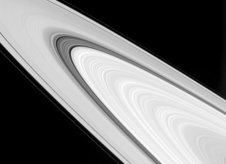 A close-up, black-and-white image of Saturn's rings