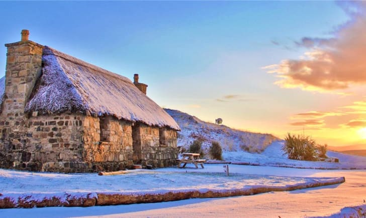 Thatched stone cottage in Scotland.