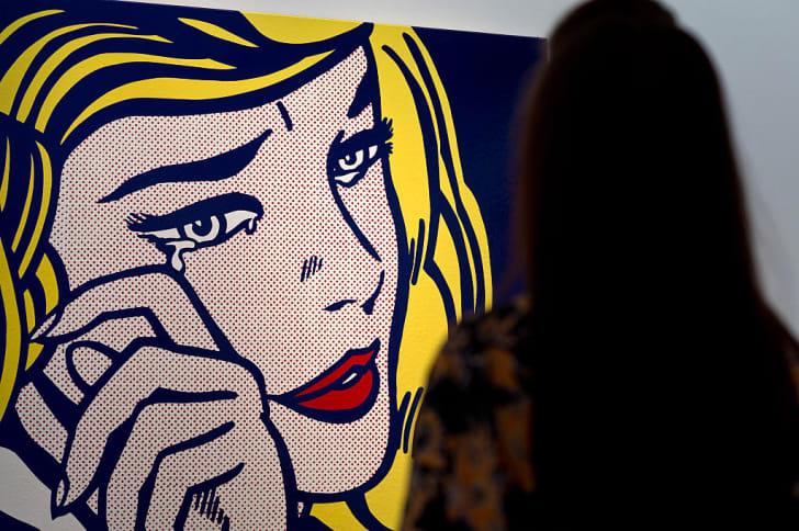 A guest views 'Crying Girl' by artist Roy Lichtenstein
