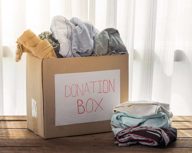 A box of clothes to be donated.