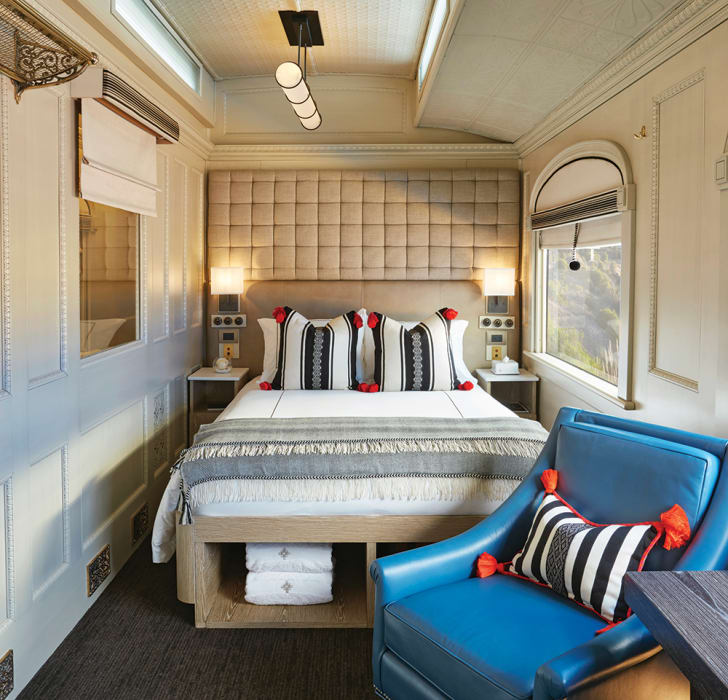A double bed in a small train car