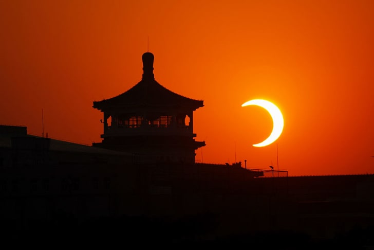 a solar eclipse at the Tian'anmen Square in China