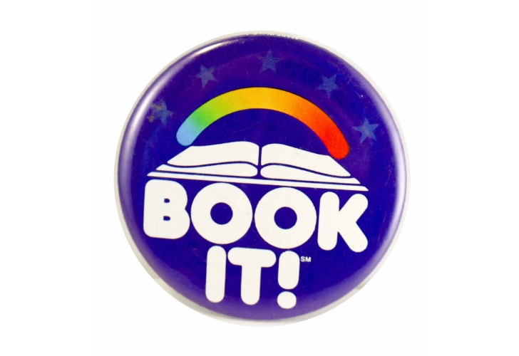 A vintage BOOK-IT pin from 1985.