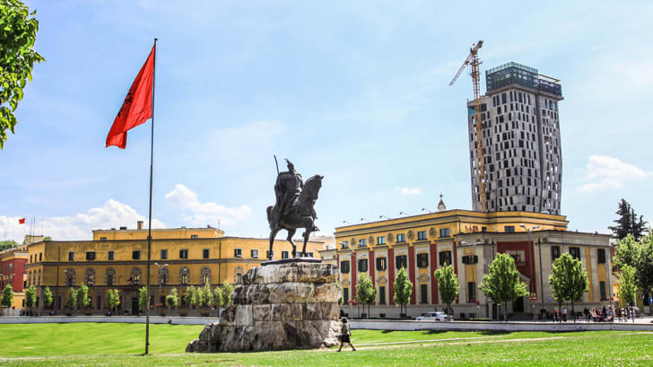 A photo of a monument to King Zog of Albania in a main square of the capital.