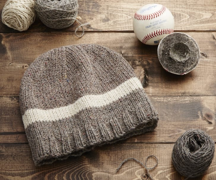 Wool cap knit from the yarn inside baseballs.