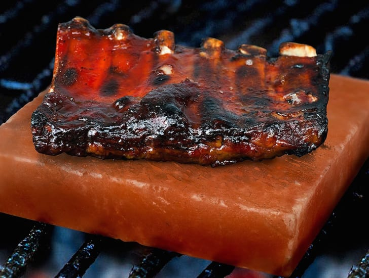 Ribs cooking on a Himalayan salt block.