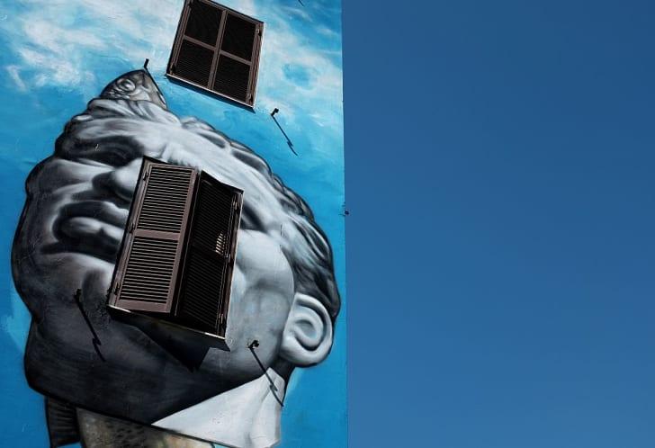 mural entitled 'Spettacolo Rinnovamento Maturita' by Gaia
