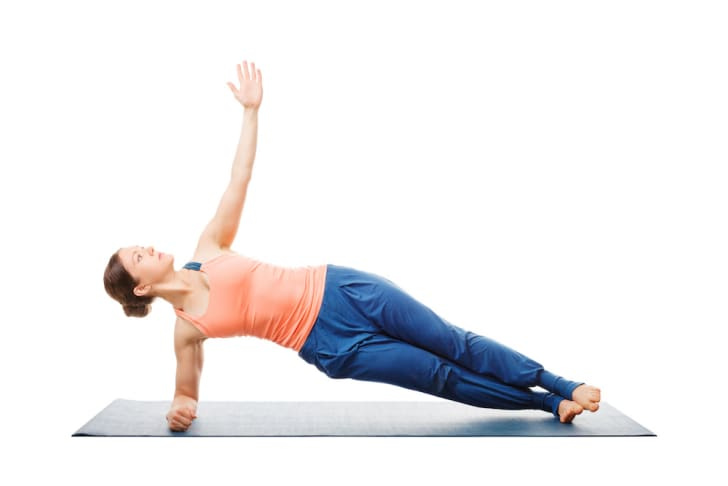 Woman doing a side forearm plank exercise
