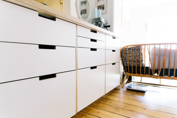 White Plykea kitchen cabinets with formica finish.
