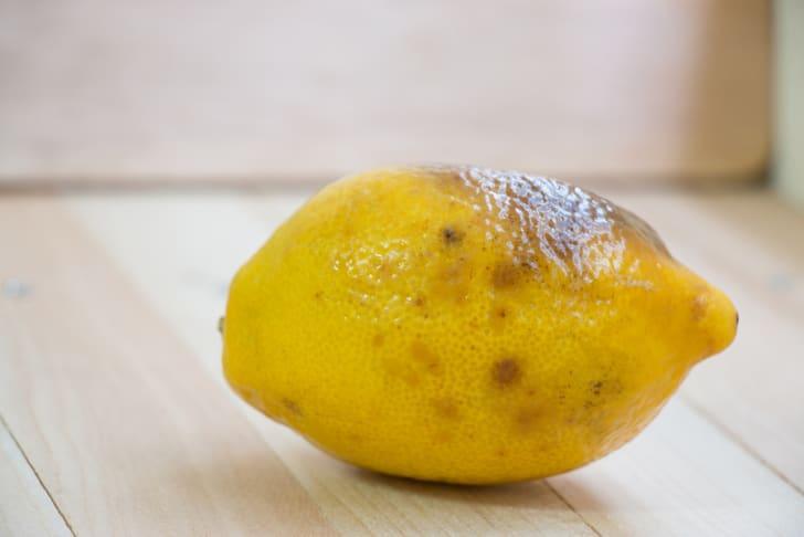 rotten lemon put on wooden table