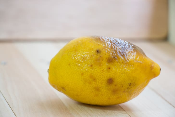 rotten lemon put on wooden table