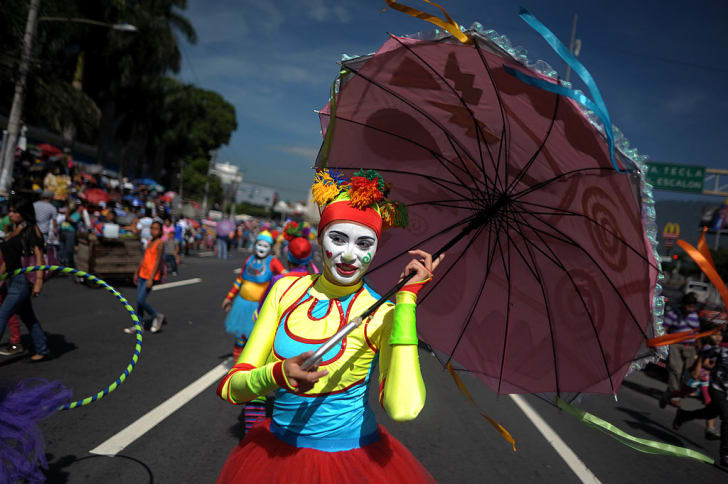 A clown performs during a parade