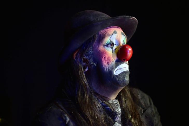 A clown sports a sad expression