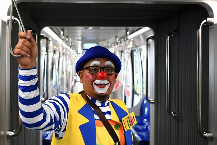 A clown takes public transportation