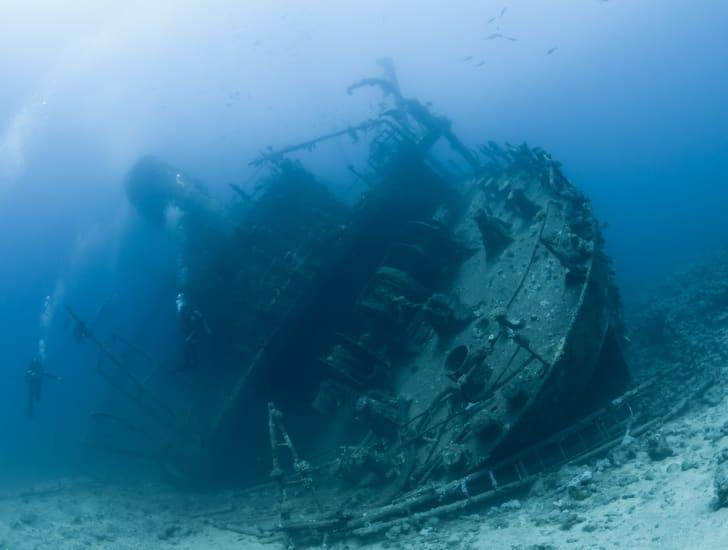 A sunken ship sits on the ocean floor