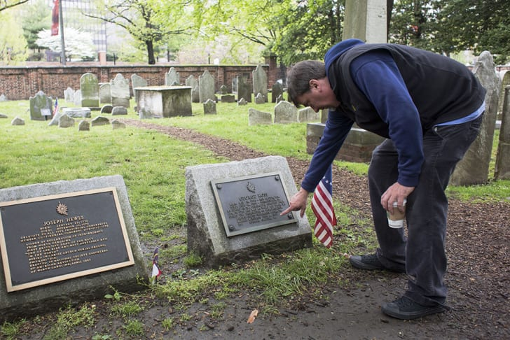 John Hopkins examines a grave in Christ Church Burial Ground.
