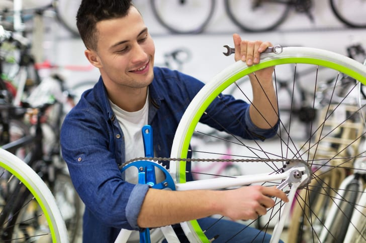 A man working on a bicycle at a cycling shop