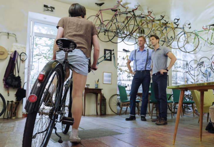 A woman trying out a bike at a bicycle shop