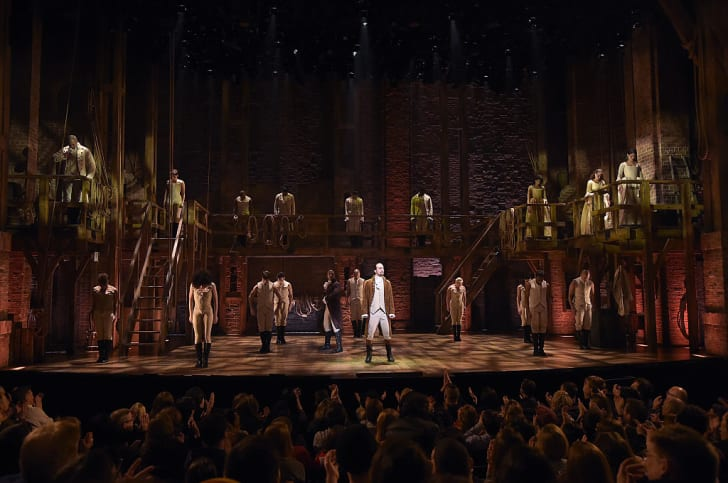 """The cast of the Broadway musical """"Hamilton"""" performing onstage."""