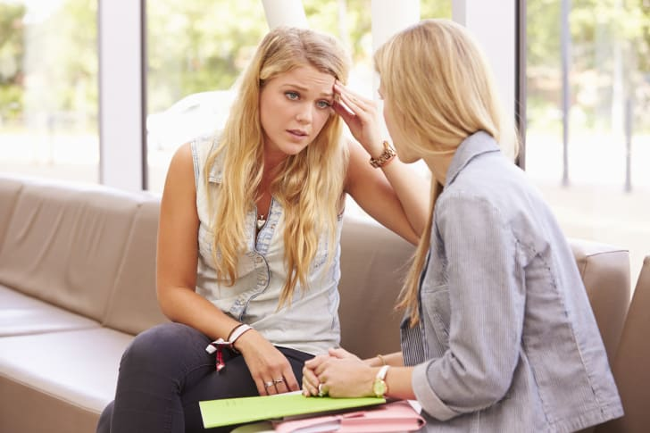Stressed student talks to counselor.