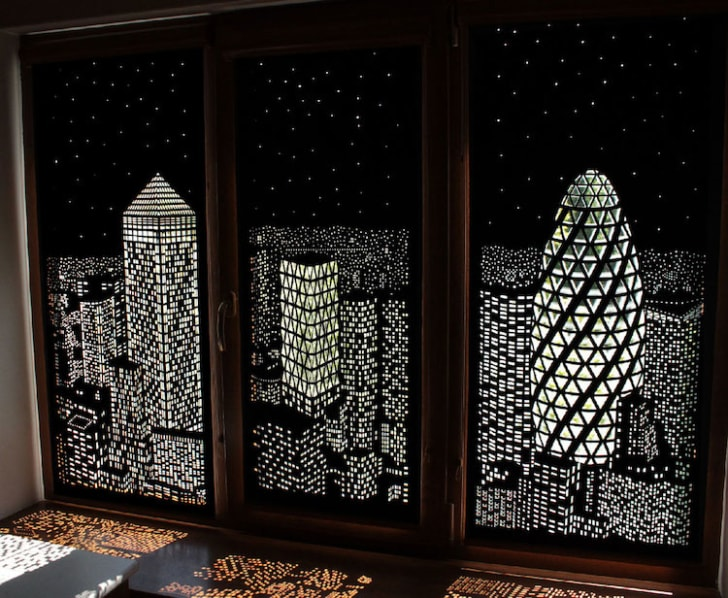 Blackout curtains depict a city skyline during the day.