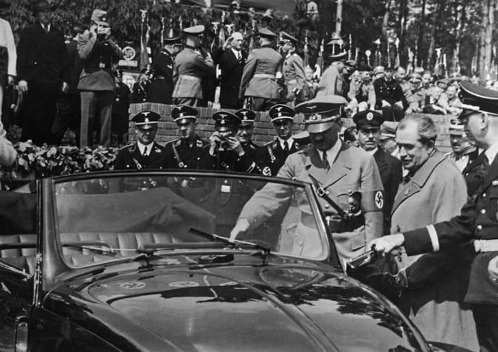 Adolf Hitler checks out a VW Beetle