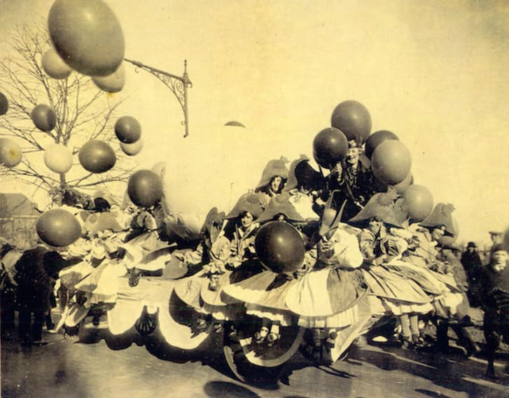 A sepia-toned photo of an early Macy's float