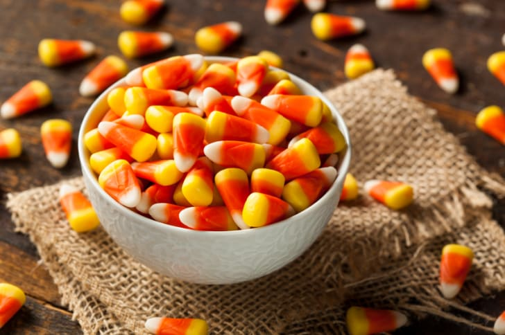A bowl full of candy corn