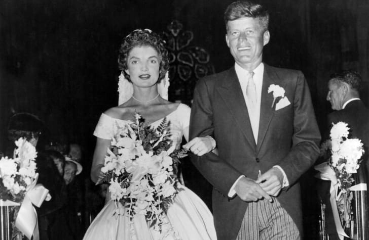 Senator John Fitzgerald Kennedy (1917 - 1963), Democratic senator for Massachusetts, escorts his bride Jacqueline Lee Bouvier (1929 - 1994) down the church aisle shortly after their wedding ceremony at Newport, Rhode Island
