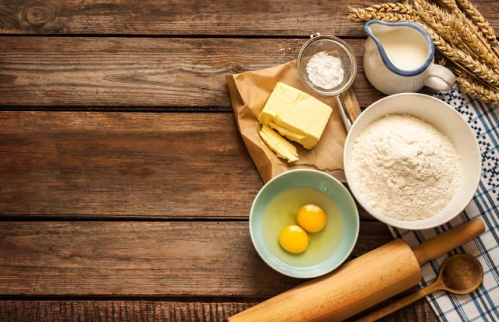 Dough recipe ingredients on vintage rural wood kitchen table