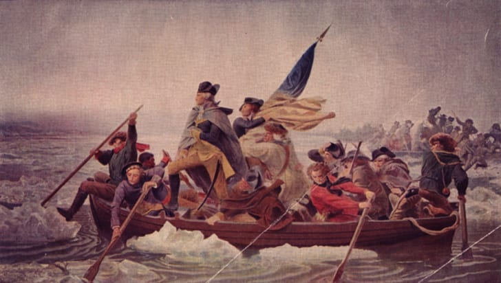General George Washington (1732 - 1799) stands in the prow of a rowing boat crossing the Delaware to seek safety in Pennysylvania after defeat by the British