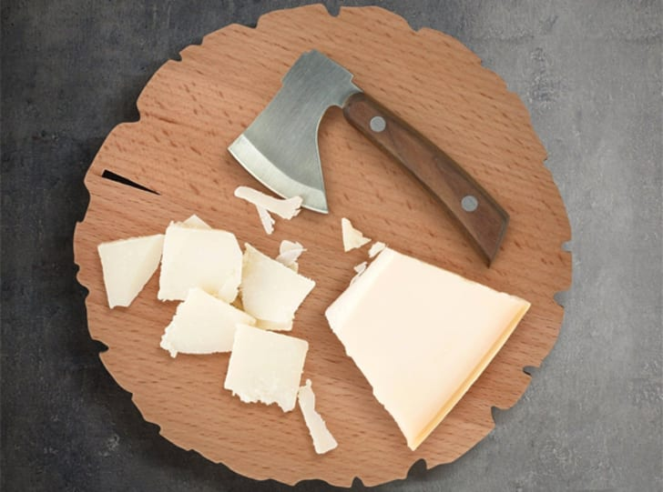 A cheese board shaped like a cut tree trunk