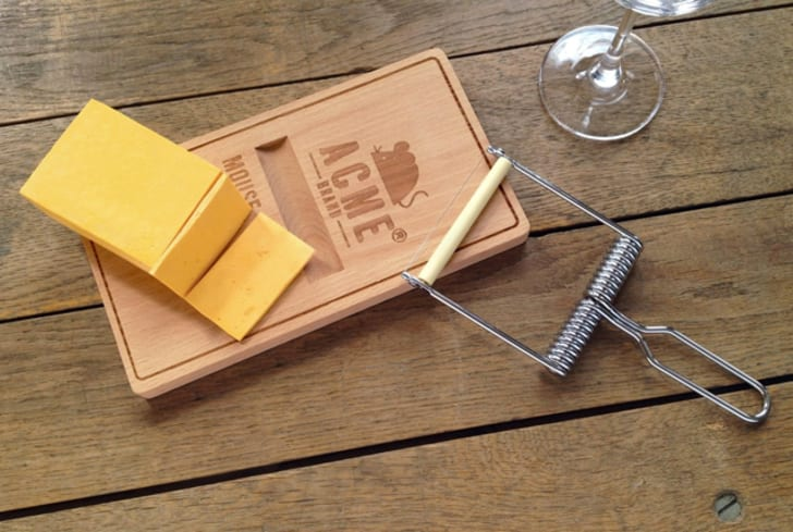 A cheese board shaped like a mouse trap