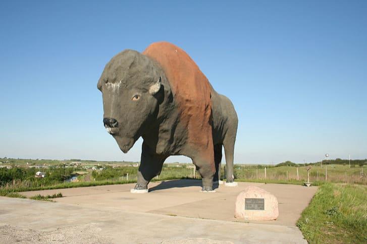 A large concrete buffalo statue