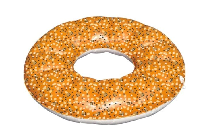 A pool float shaped like an everything bagel