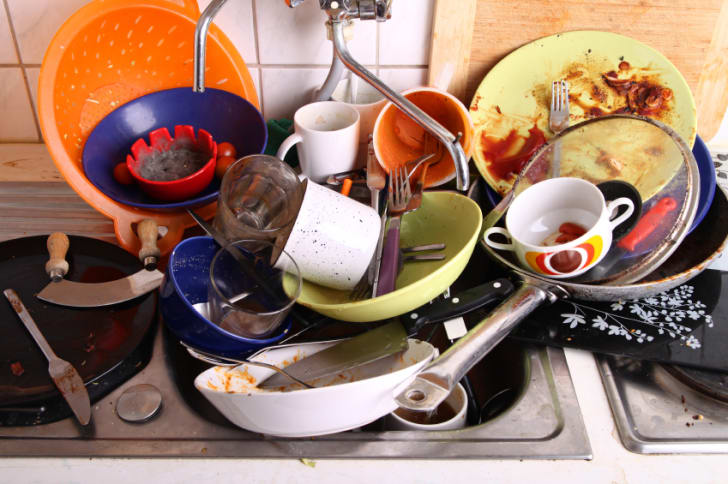 A sink filled with dirty dishes