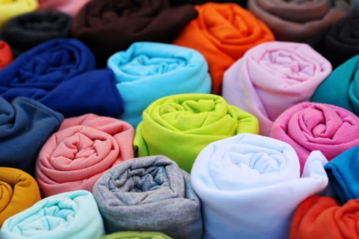 Photo of a several rolled up T-shirts
