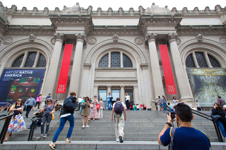 A crowd on the steps of the Metropolitan Museum of Art in NYC