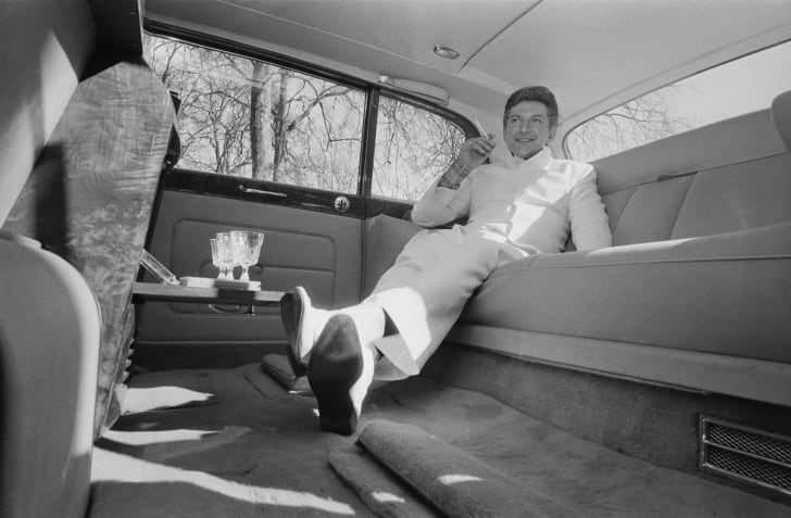 Liberace in the back seat of a limo